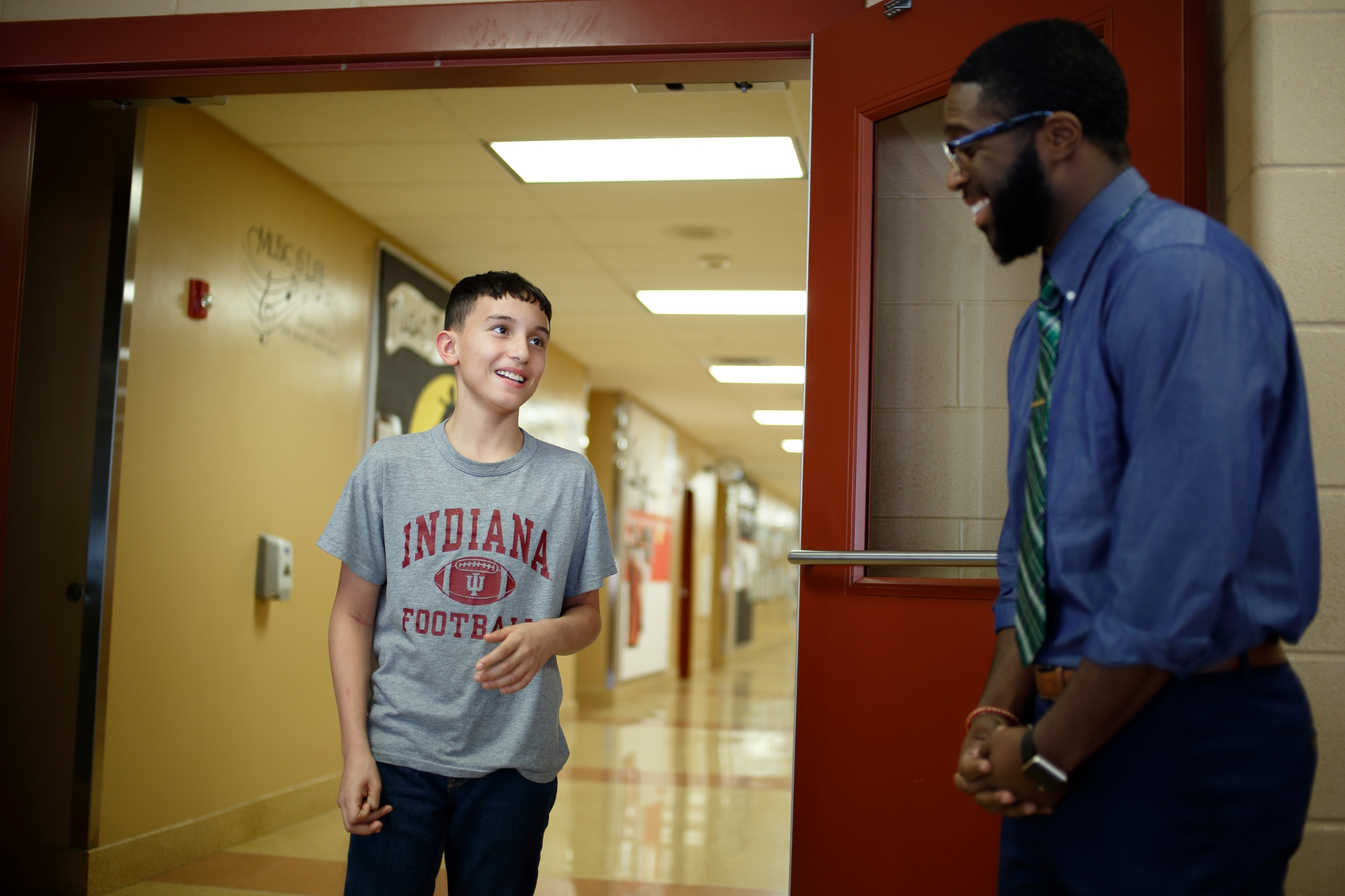 IU staff member mentoring youth at Fairview elementary school.
