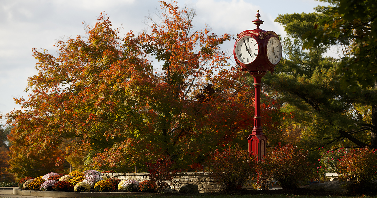 IU Clock Tower surrounded by Fall leaves.